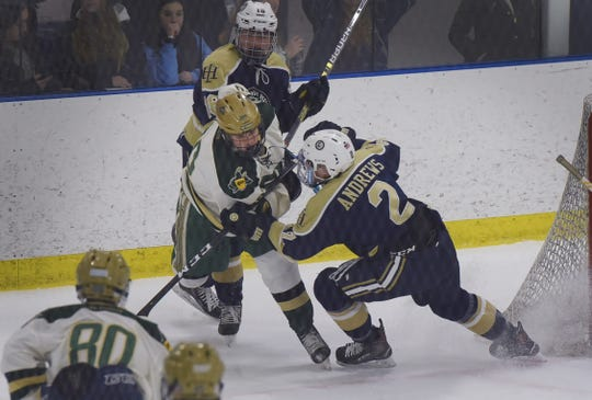 Ryan Andrews (no.2) of Indian Hills battles with Dean Tobin (no.10) of St. Joseph in the first period during the the Bergen County hockey semifinals at Ice Vault Arena in Wayne on 01/21/19.