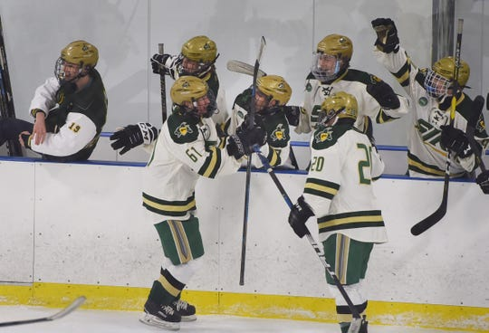 Justin Rauch (no. 61) of St. Joseph is celebrated by his teammate after scoring his goal against Indian Hills in the  period during the the Bergen County hockey semifinals at Ice Vault Arena in Wayne on 01/21/19.