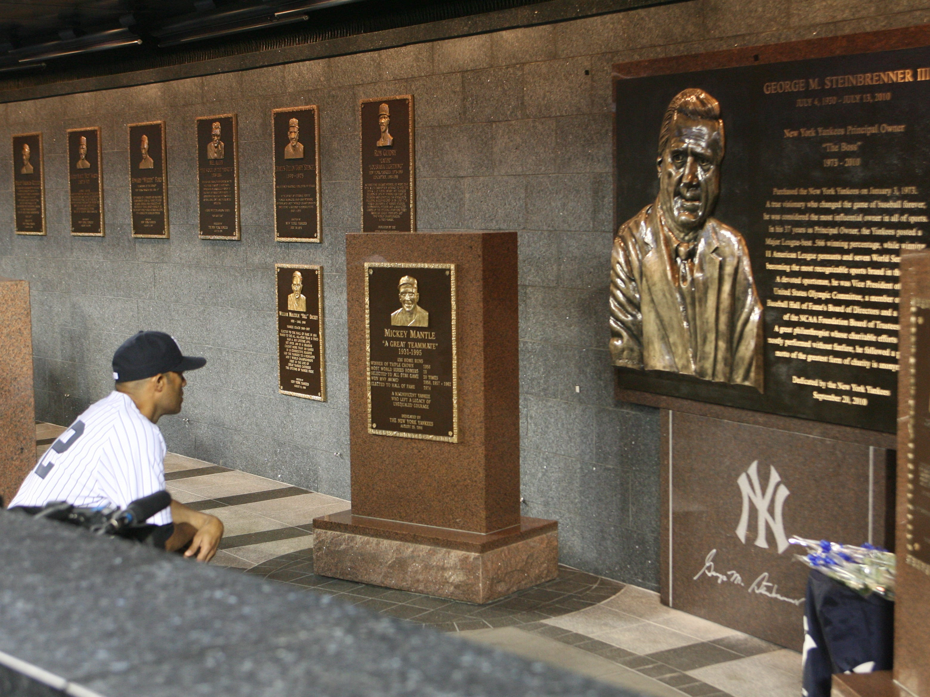 Dedication of the George Steinbrenner Monument in Monument Park at Yankee Stadium.  Mariano Rivera takes a moment to look at the plaque.