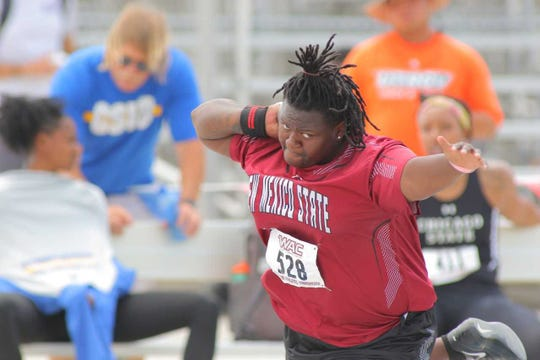 Taniya Mitchell competes in weight throw and shut put for NM State.