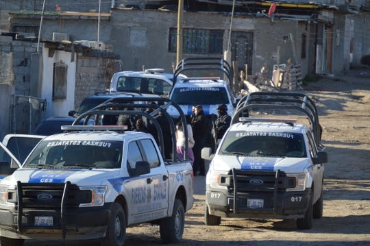 Police in Colonia Rancho Anapra Mexico raid a suspected stash house where a teen from Guatemala and his father reported they had been held against their will.
