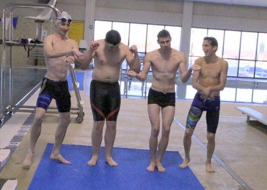 Left to right: Matthew Pavlik, Jared Rea, Tyler Plant and Jacob DeMichele relieve some stress by dancing in between laps. The Carlsbad swimmers also do power poses like Superman to help get in the right mindset before races.