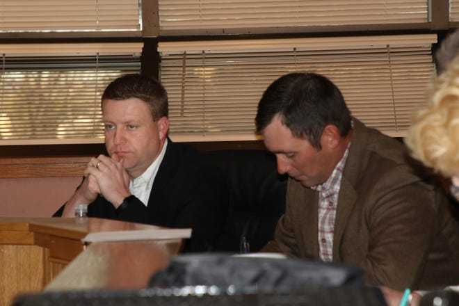 (From left)-Eddy County Board of Commissioners Jon Henry and Steve McCutcheon listen during Tuesday's meeting.
