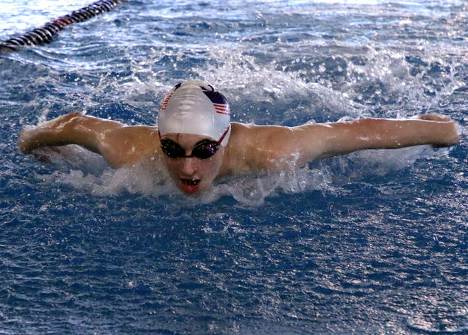 Carlsbad sophomore Matthew Pavlik works on his butterfly stroke during pracitce.