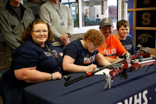 Piedra Vista's Amoret McCartney signs her national letter of intent on Tuesday to continue her career with UTEP's women's rifle program.