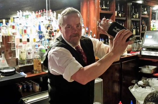 Ed Krause mixes a drink behind the bar at Ranchers in Ruidoso.