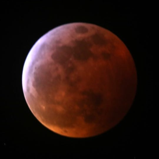 The blood moon at its ruddiest in earth's shadow.