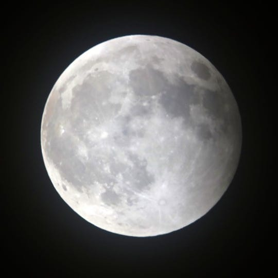 The moon emerged from the earth's shadow.