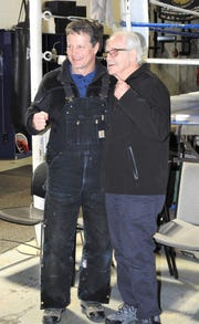 Dynamic Boxing Club owner Chuck Phillips (left) and trainer Paul Soucy have a long history.