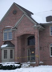 This home in Northville Township, with yellow caution tape near its front door, sustained damage in a recent fire.