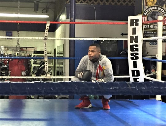 Detroit's Ja'Rico O'Quinn takes a breather during a recent training session at Westland's Dynamic Boxing Club.