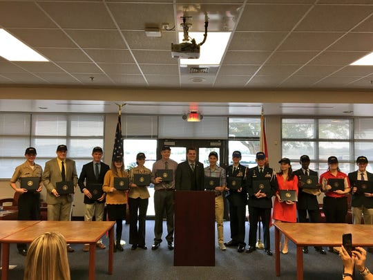 Rep. Matt Gaetz stands for a photo with students he nominated for U.S. military academies at an event Tuesday at Pace High School.