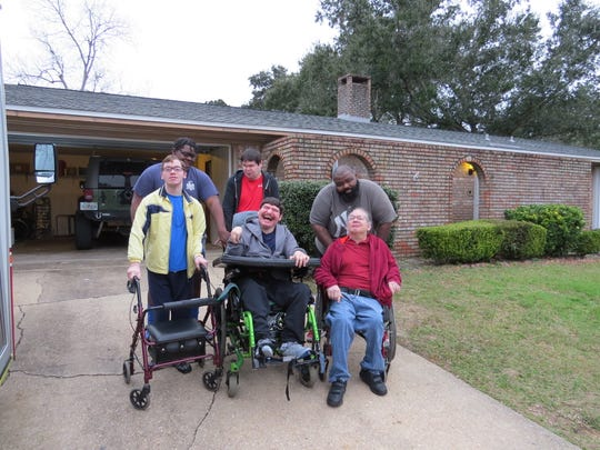 One of Capstone Adaptive Learning and Therapy Centers' group homes received a new roof thanks to a collaborative effort by local businesses.