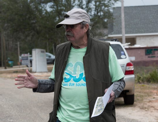 Gulf Breeze resident Michael Brower talks Tuesday about his concerns for a new development planned north of U.S. 98 in Midway.