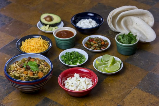 Vegetarian chili with couscous and toppings are pictured on Thursday, Jan. 17, 2019, at Robin Miller's home in Scottsdale, Ariz.