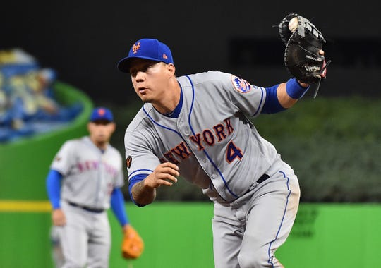 Apr 10, 2018: New York Mets first baseman Wilmer Flores (4) fields the ball before making an out in the third inning against the Miami Marlins at Marlins Park.