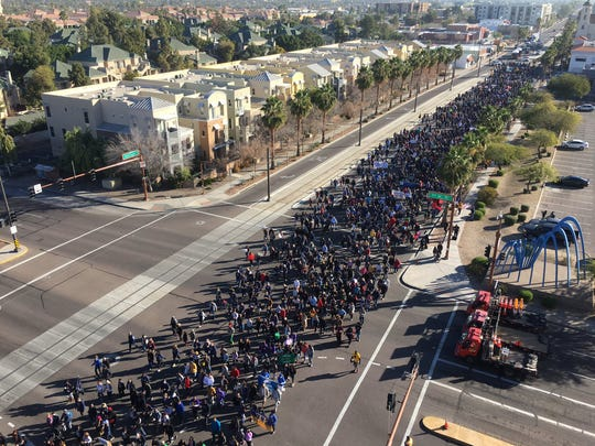 Thousands of people  in the MLK march in Phoenix pass 7th Street Monday, Jan. 21, 2018.