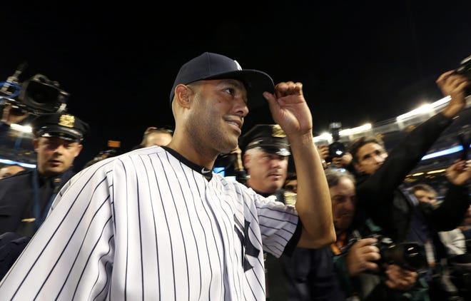 Mariano Rivera tips his cap to the fans after his final game of his career.