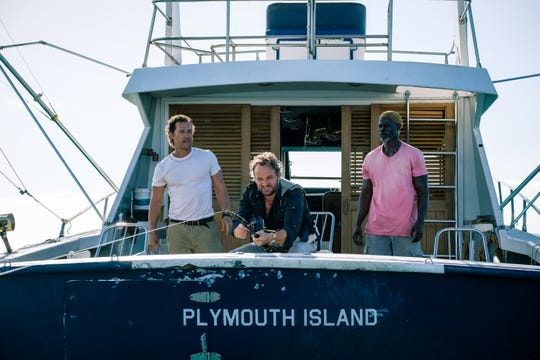 "In ""Serenity,"" Frank (Jason Clarke, center) is taken on an unusual fishing trip by Dill (Matthew McConaughey, left) and Duke (Djimon Honsou)."