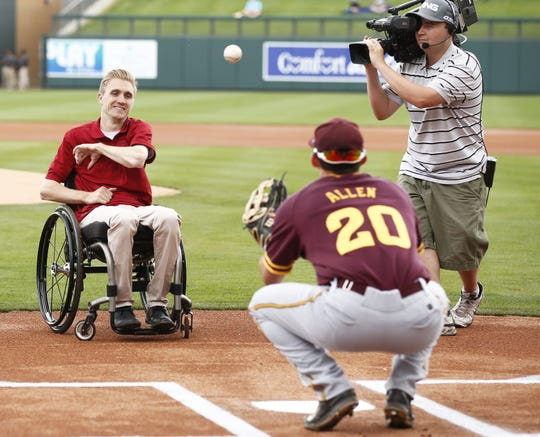 Cory Hahn throws out the first pitch to ASU's Trever Allen during a spring training exhibition game on Tuesday, Mar. 3, 2015.