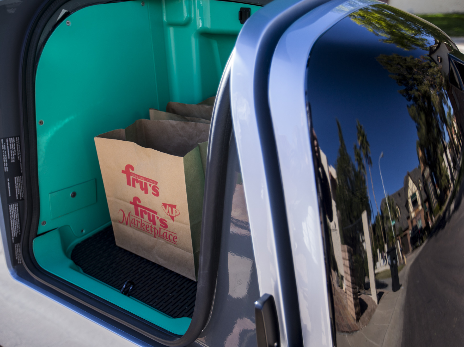 An autonomous Nuro vehicle drives near Eldorado Park on Jan. 22, 2019, in Scottsdale, Ariz. Nuro has partnered with Fry's Food Stores to use the robot vehicles to deliver groceries in Scottsdale.