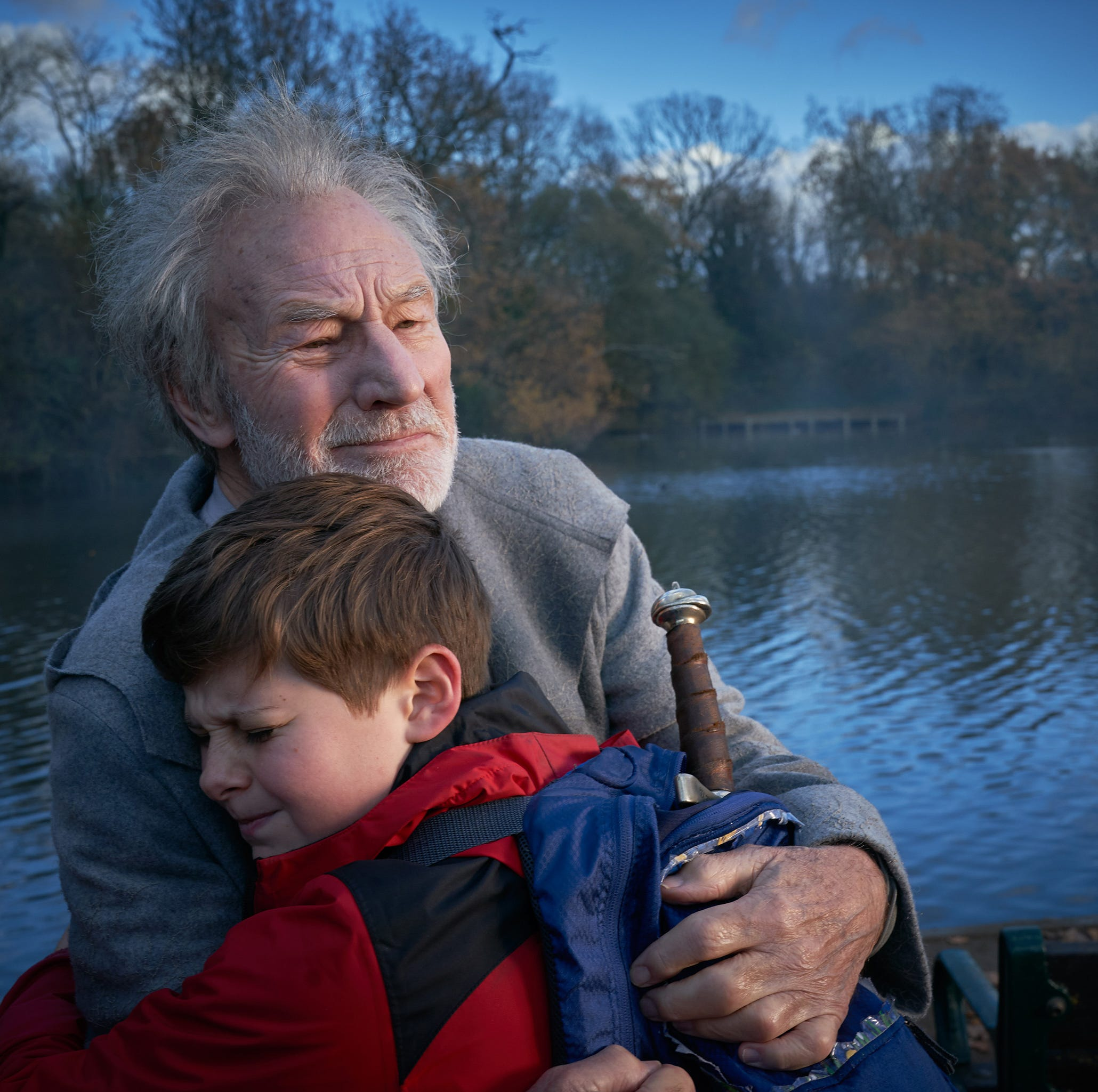 """Louis Ashbourne Serkis (front) and Patrick Stewart star in """"The Kid Who Would Be King."""""""