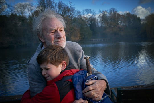 "Louis Ashbourne Serkis (front) and Patrick Stewart star in ""The Kid Who Would Be King."""