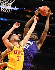 TCU Horned Frogs center Kevin Samuel (21) and USC Trojans forward Nick Rakocevic (31) go for a rebound in the first half of the game at Staples Center Dec. 7.  Jayne Kamin-Oncea-USA TODAY Sports