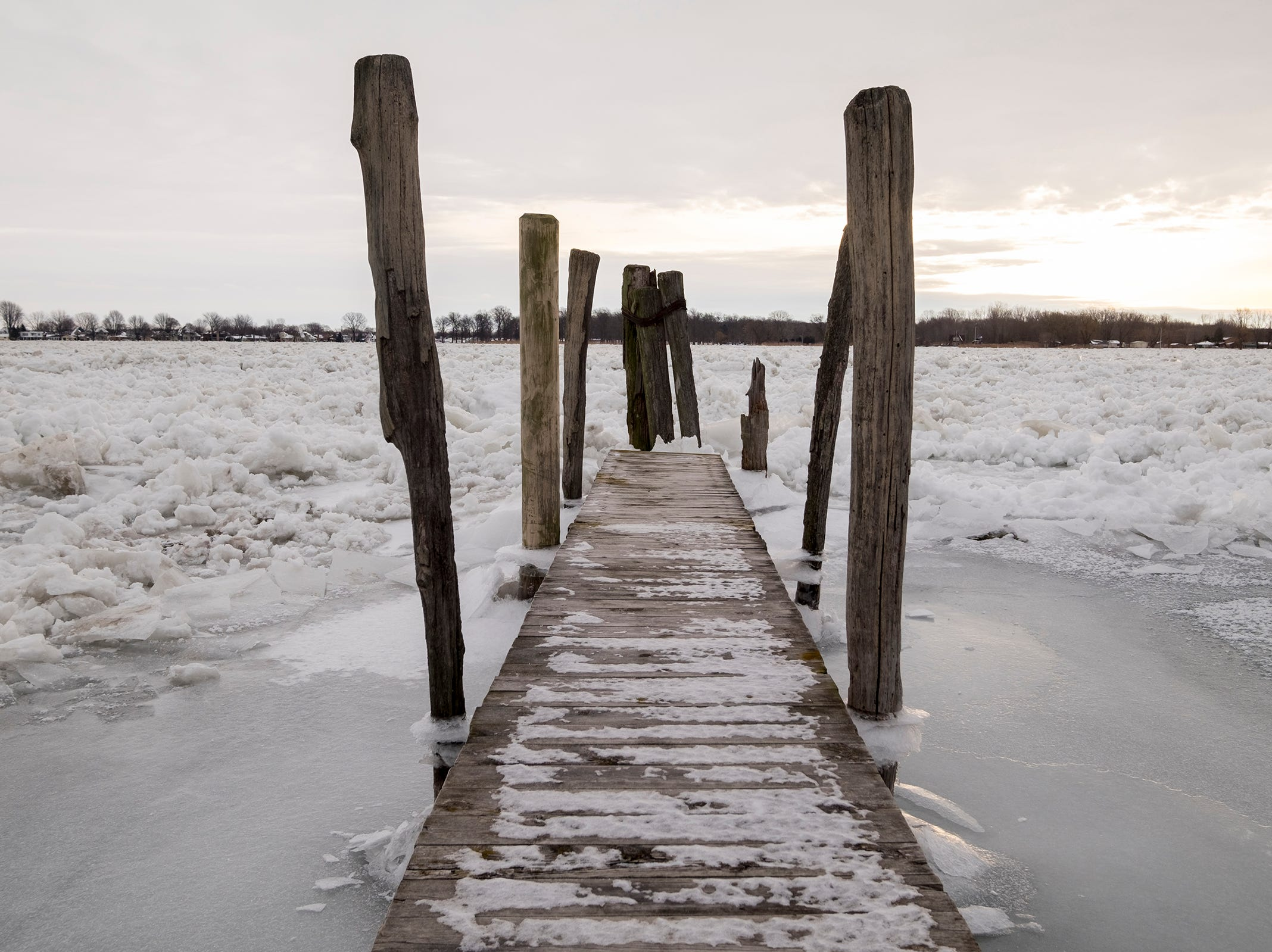 A dock on the St. Clair River is surrounded by ice Tuesday, Jan. 22, 2019, near Algonac.