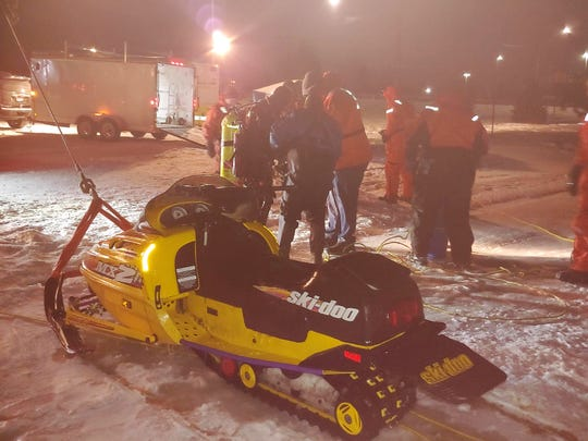 Members of the Dive Team Auxiliary recovered a snowmobile from the Black River on Sunday, Jan. 20, 2019.