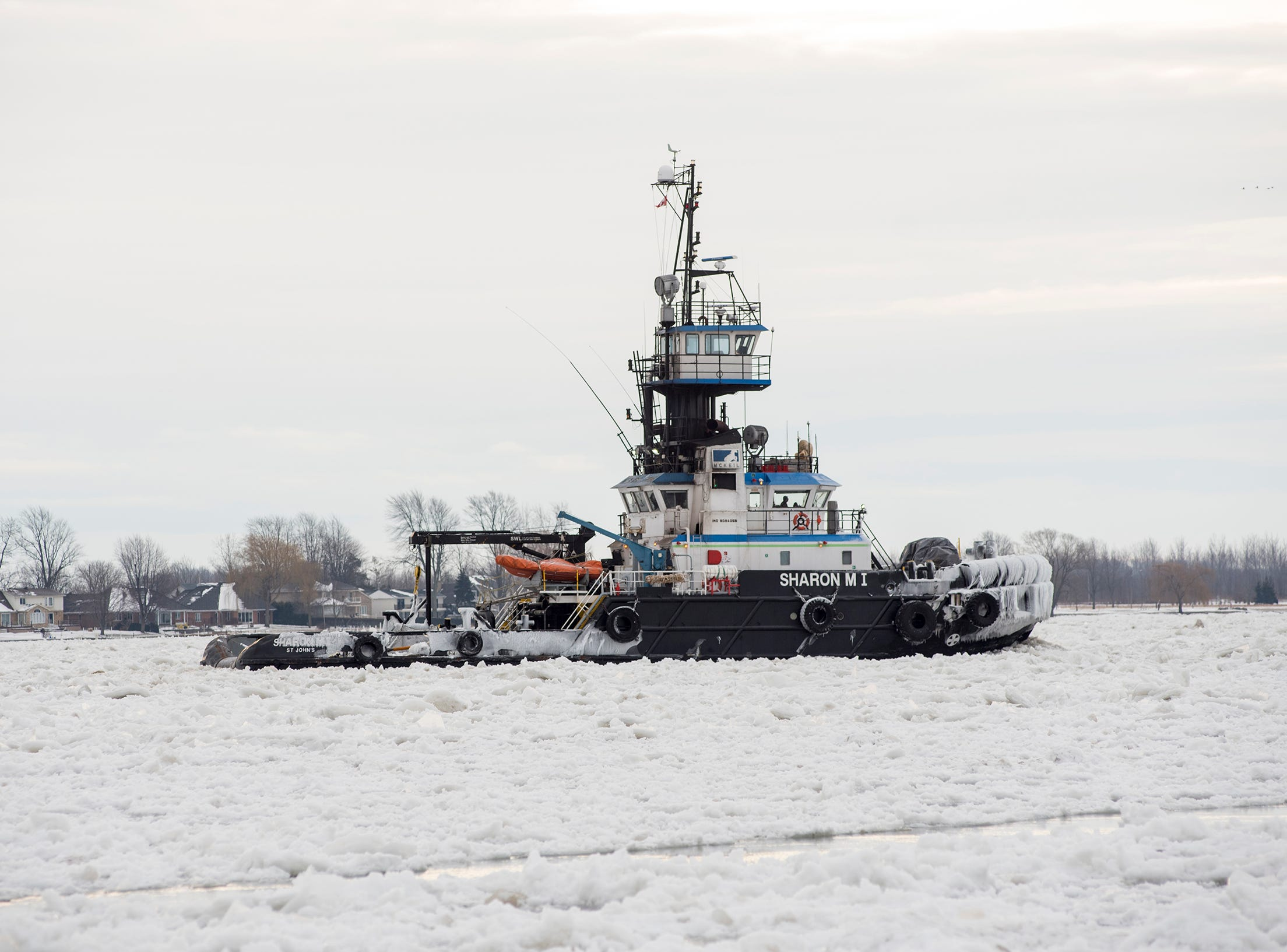The Sharon M I tug is seen downbound through ice on the St. Clair River north of Marine City Tuesday, Jan. 22, 2019.