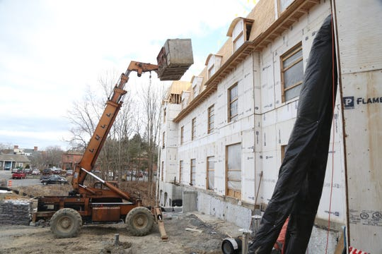 A forklift moves materials to the roof of Mirbeau Inn and Spa in Rhinebeck on January 16, 2019.