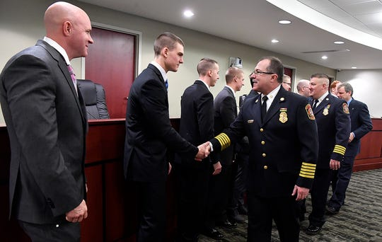 York City Department of Fire/Rescue Services Chief David Michaels welcomes the nine new firefighters sworn in, Tuesday, January 22, 2019. A tenth will be sworn in Monday after returning from a military deployment.  