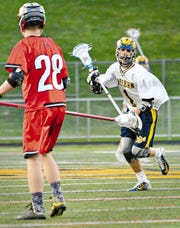 Eastern York's Bryce Henise, right, committed to play lacrosse at Robert Morris University.