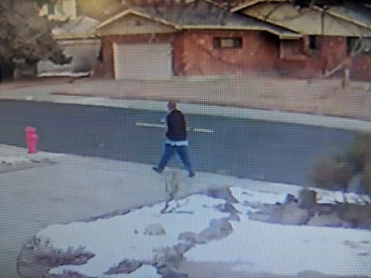 A surveillance image of a man suspected of stealing a car Tuesday morning with a child still strapped into a booster sear in the backseat. The child and vehicle were later found unharmed.