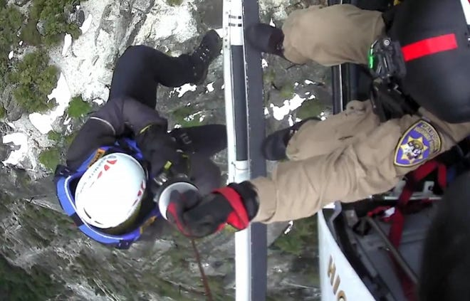 A screenshot of video that the California Highway Patrol released of the dramatic rescue of two British tourists who were trapped on the edge of a massive granite cliff overlooking the Yosemite Valley.