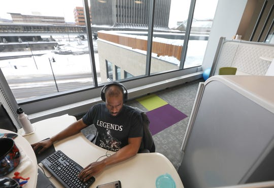 Stanley Monu, software developer, works on a project at Second Avenue Learning.