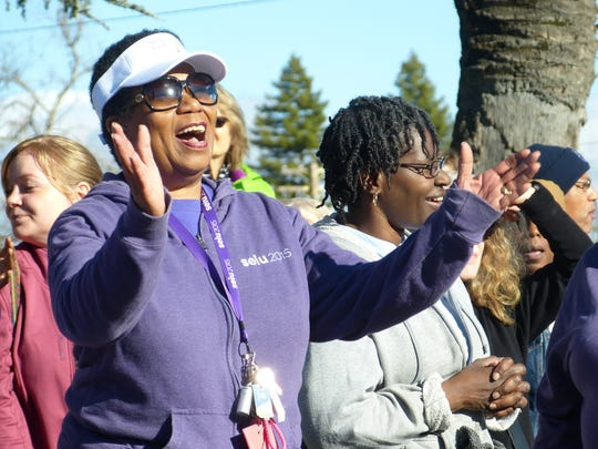 Jackie Morganfield sings during Redding's Martin Luther King Jr. Day celebration outside the Shasta County courthouse on Monday.