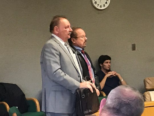 Dr. Larry Richard Pyle, right, stands with his attorney, John Kucero, on Tuesday in Shasta County Superior Court.