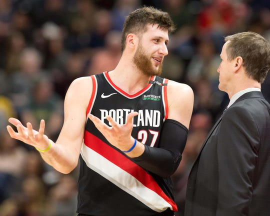 Portland Trail Blazers center Jusuf Nurkic (27) talks with head coach Terry Stotts during the second half against the Utah Jazz at Vivint Smart Home Arena.