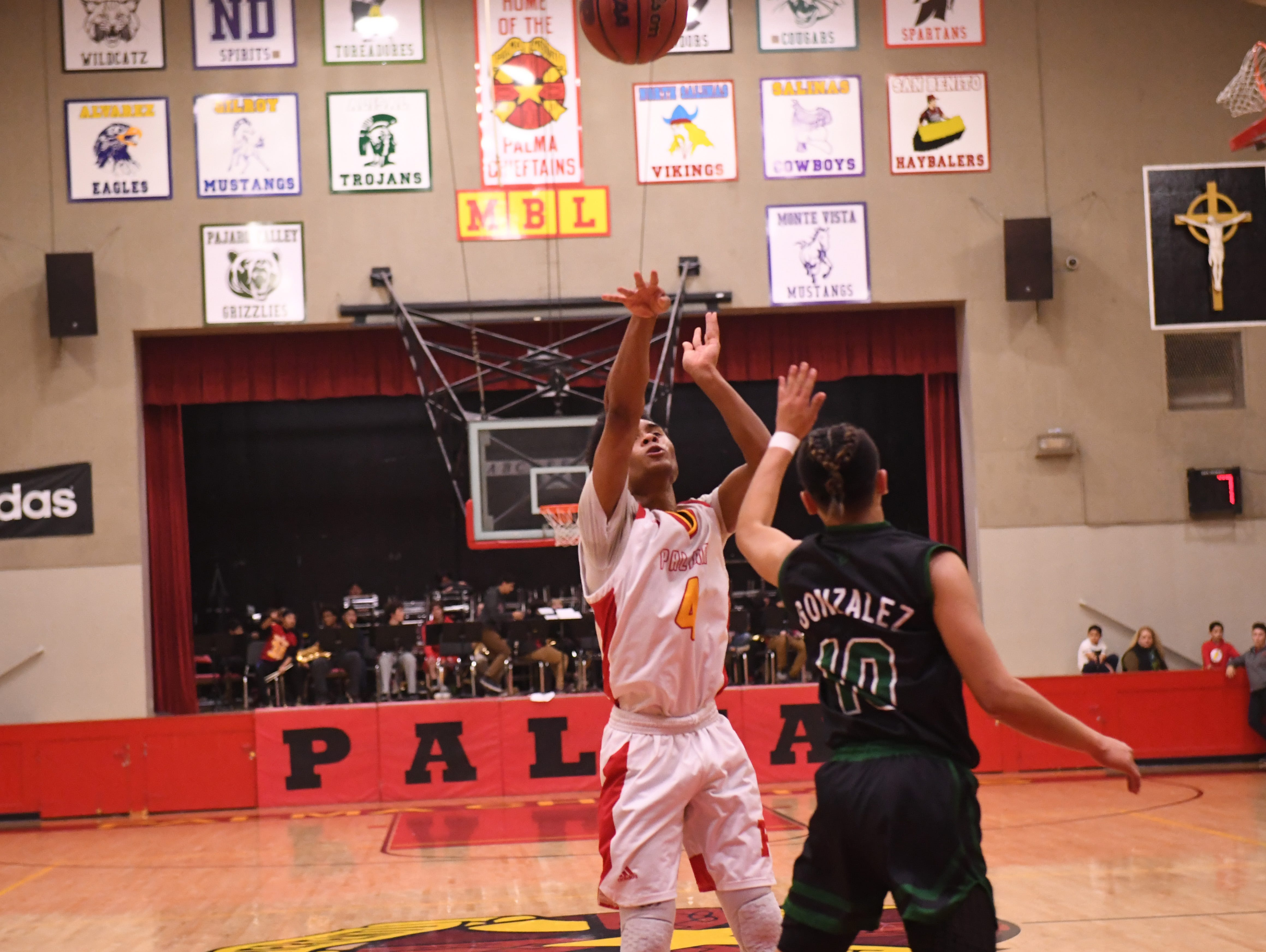 Palma guard Donte Jean Pierre (4) fires off a shot from the top of the key.