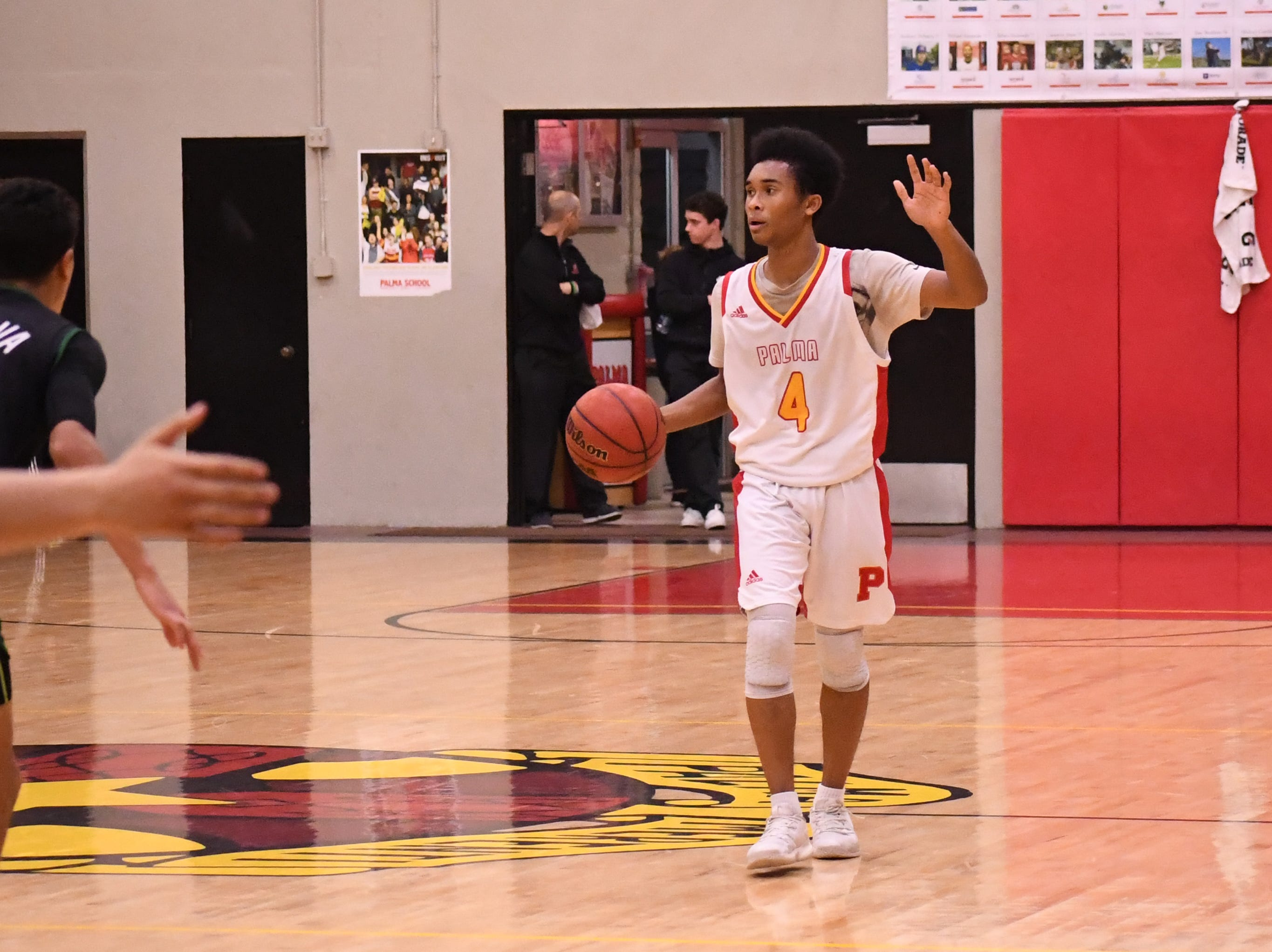 Palma guard Donte Jean Pierre (4) calls a play on offense.
