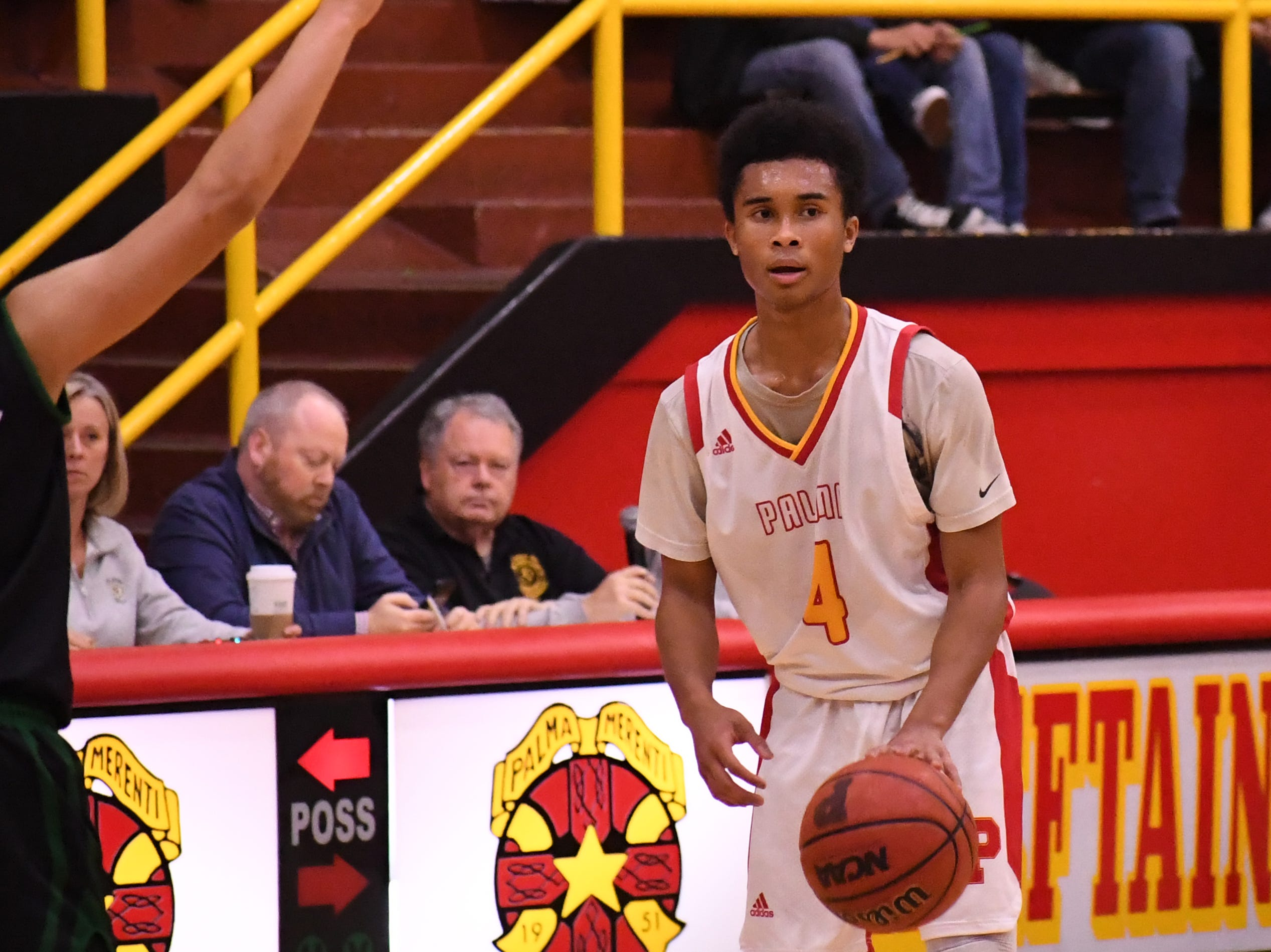Palma guard Donte Jean Pierre (4) looks to pass on offense.