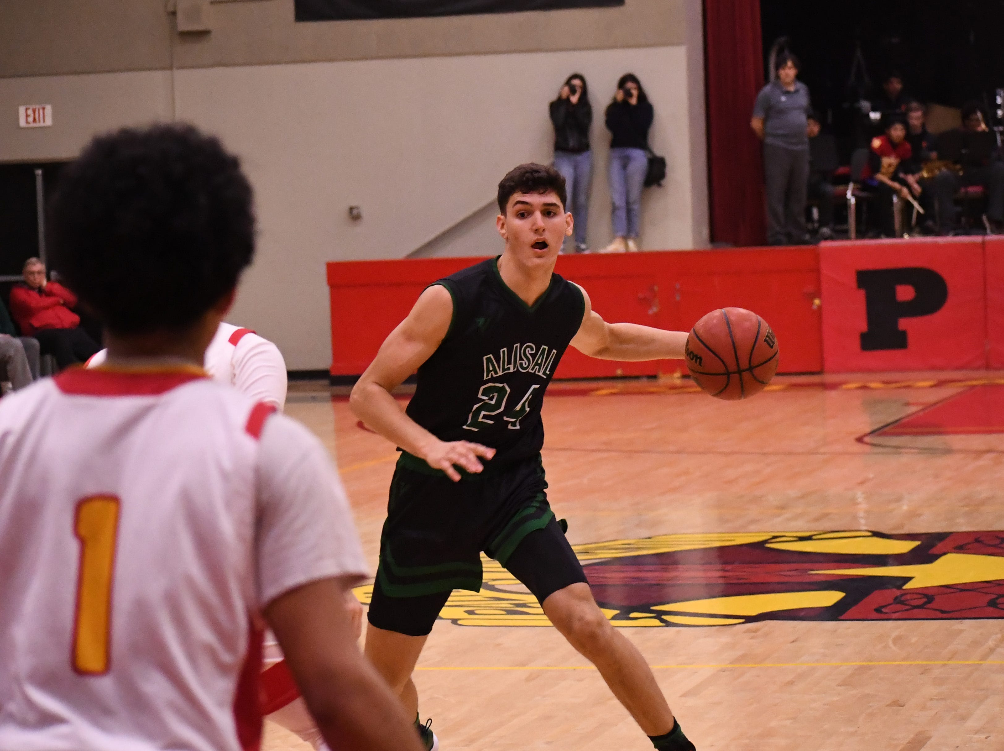 Alisal forward Sebastian Reynoso (24) fakes to the left before driving right to the paint.