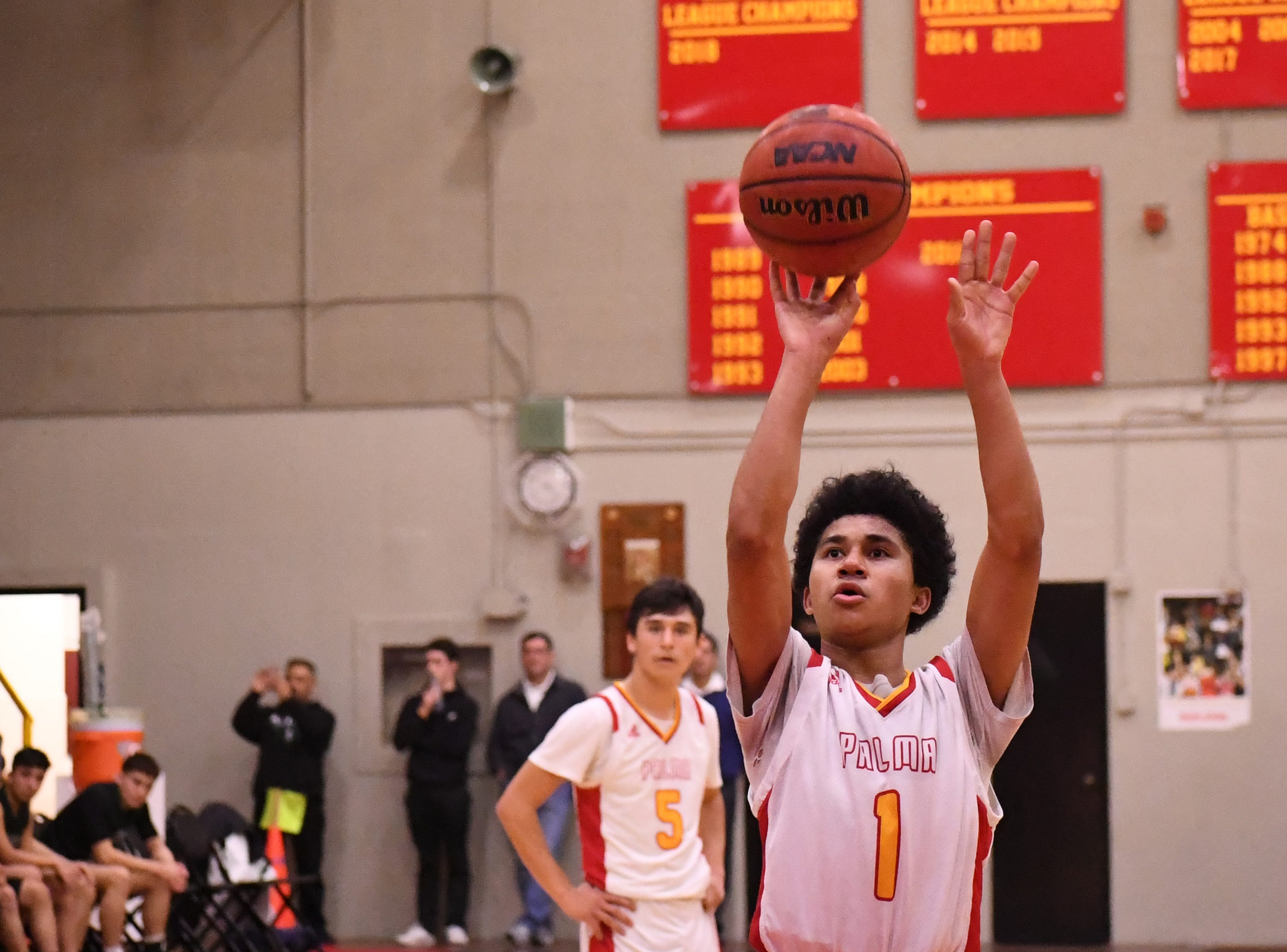 Palma guard Nate Jean Pierre (1) shoots a free throw in the waning minutes of the fourth quarter.
