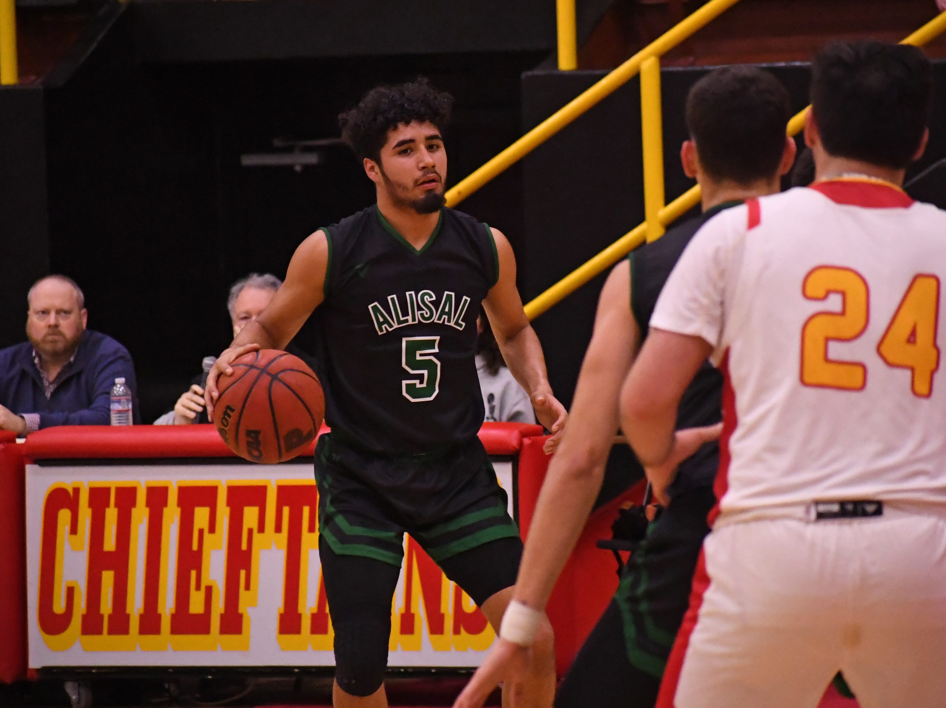 Alisal forward Israel Corona (5) waits for a play to develop before passing.