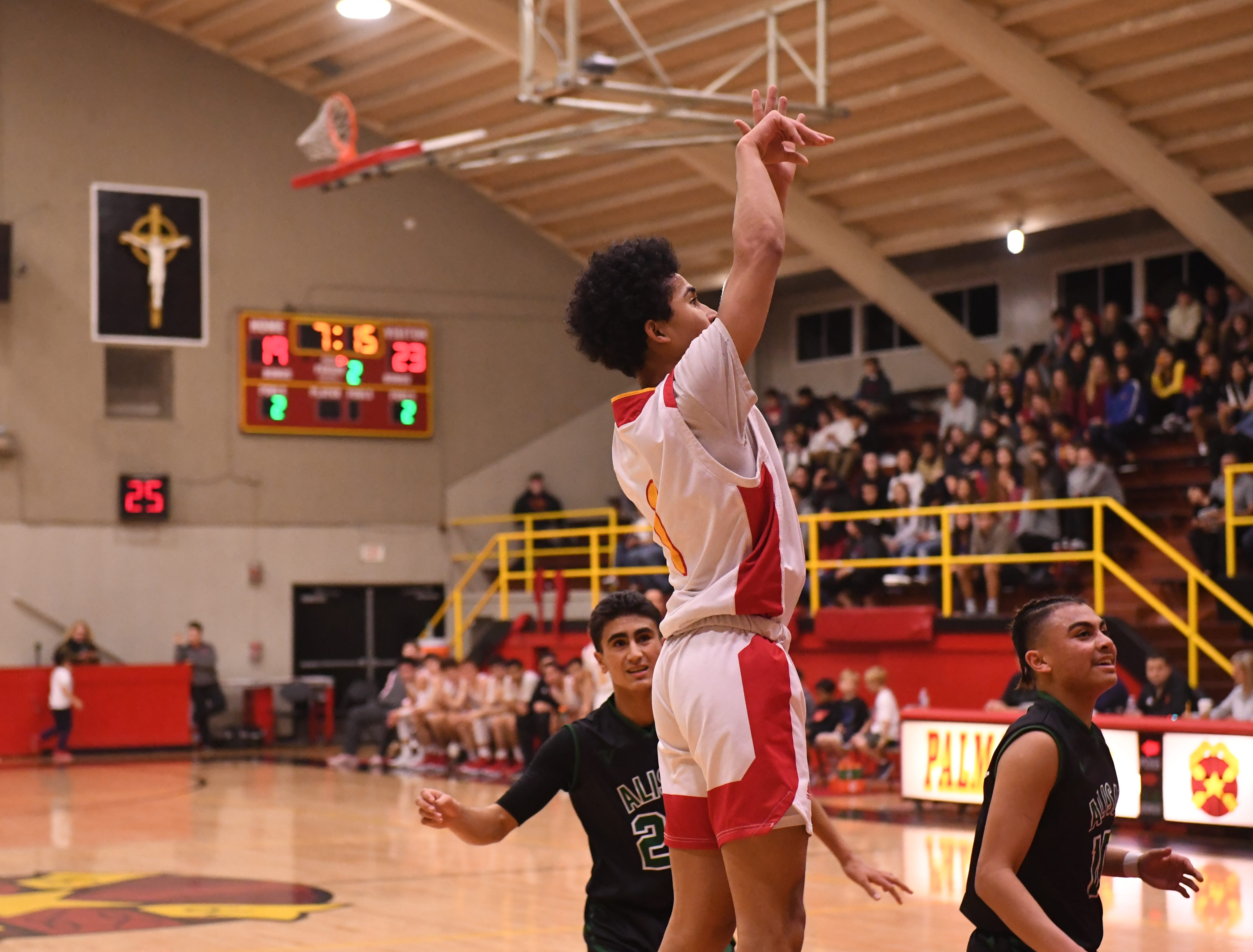 Palma guard Nate Jean Pierre (1) launches a shot from the right baseline.