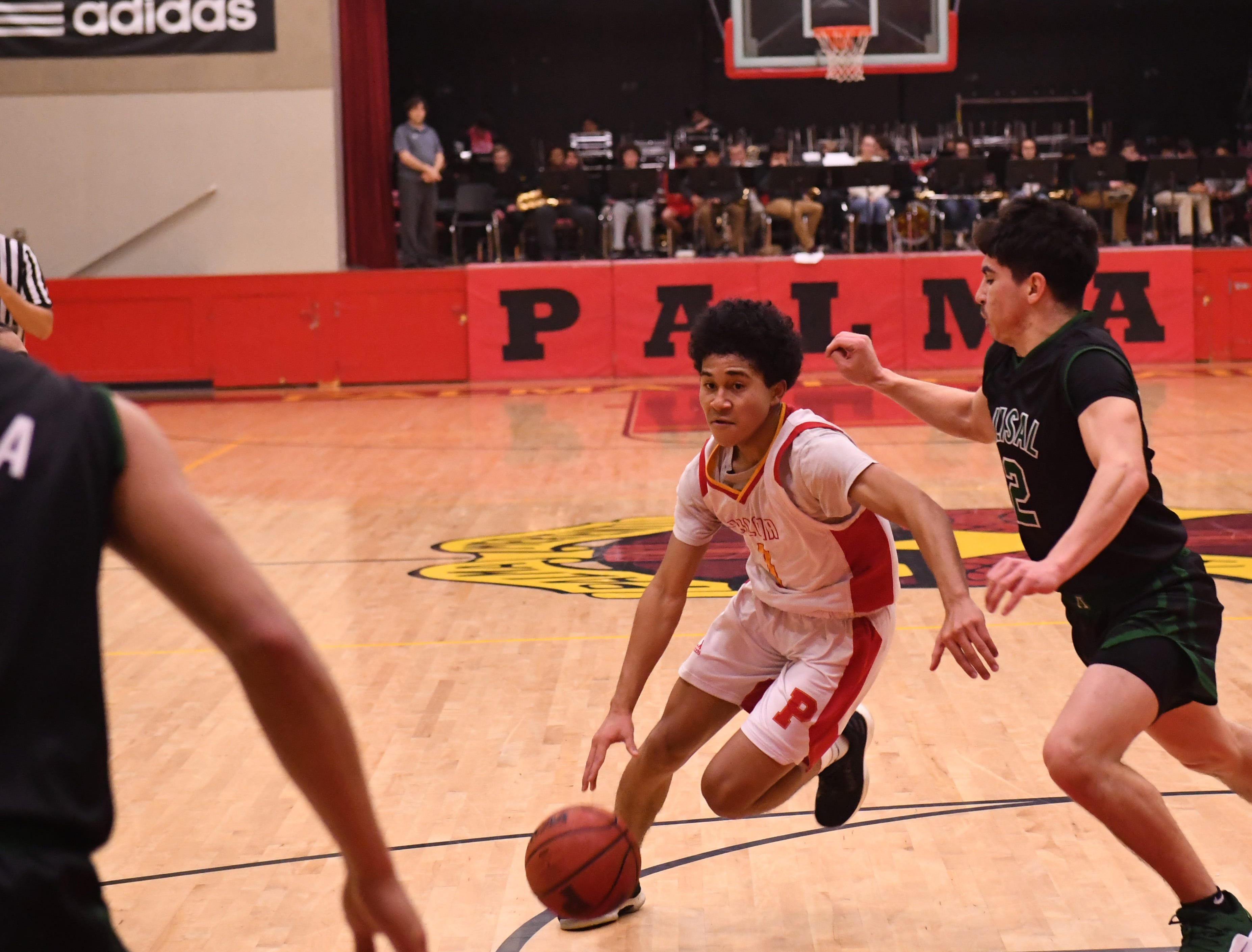Palma guard Nate Jean Pierre (1) drives through the paint in the second quarter.
