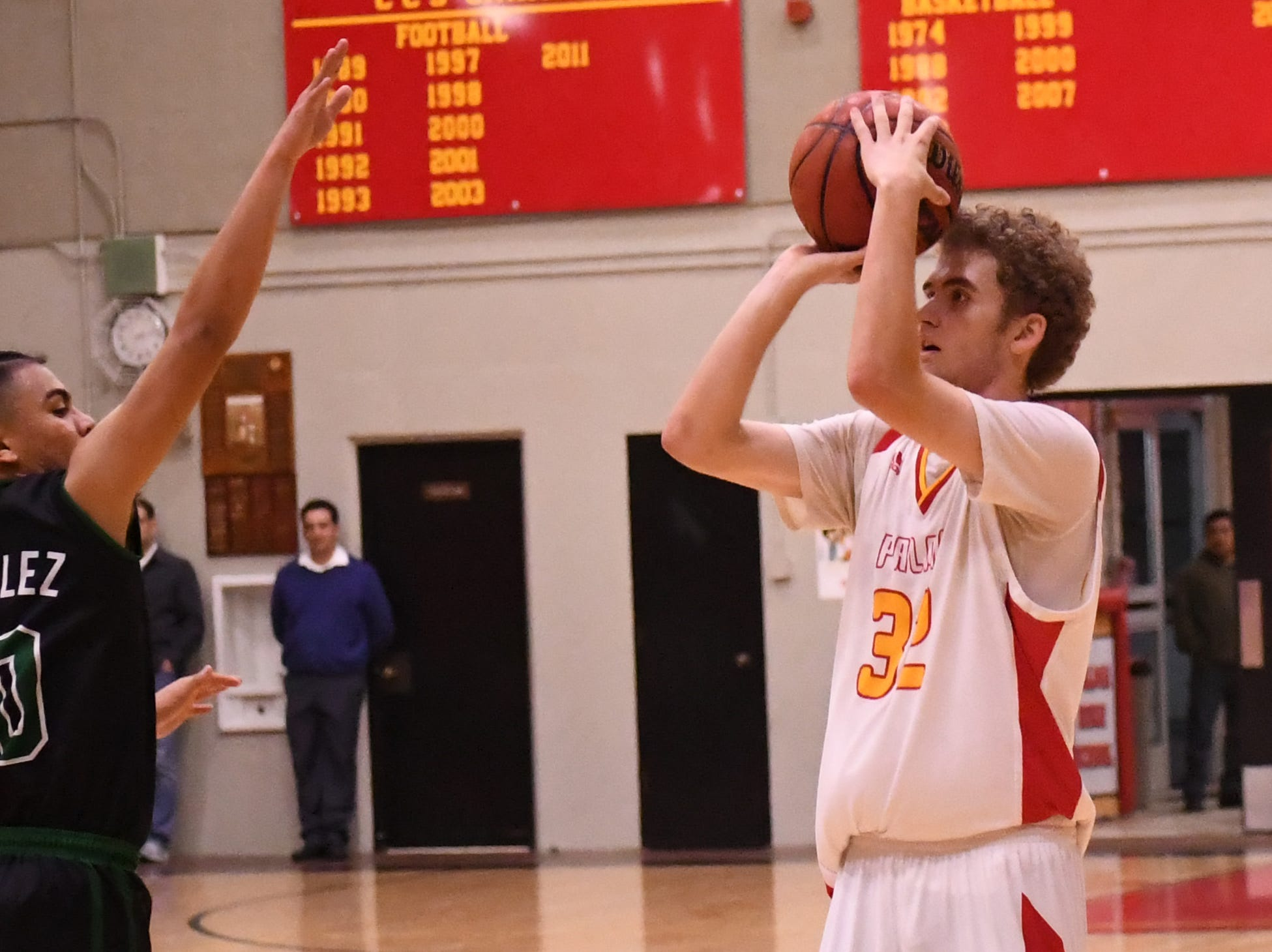 Palma forward Colin Neff (32) readies to release a 3-pointer in the face of defense from Alisal guard Vincent Gonzalez (10).