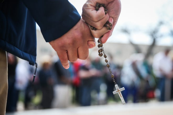 People hold hands during a silent prayer Tuesday, Jan. 22, 2019, at the Tom Green County Courthouse. The pro-life event was set on the 46th anniversary of the Supreme Court ruling on Roe v. Wade.